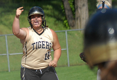 Southern Columbia's Taylor Hoffman celebrates after hitting a triple and earning an RBI helping her team defeat Muncy 3-2 Wednesday May 30, 2012 at Elm Park in Williamsport.