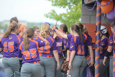 The Danville softball team huddles up inbetween innings during their game against Shamokin on Tuesday.