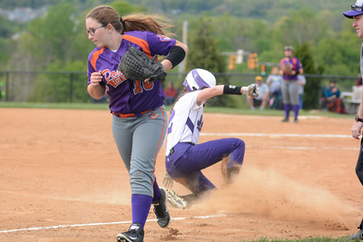 Shamokin's Maryssa Erdman slides safely into thrid base past Danville's Taylor Brosious during Tuesday's game.
