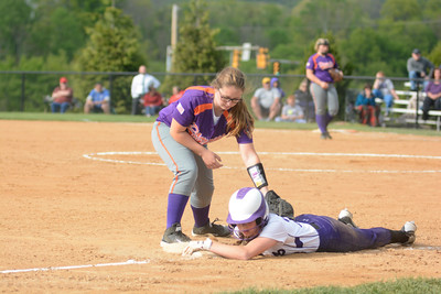 Danville's Taylor Brosious tries to tag out Shamokin's Maryssa Erdman at third base during Tuesday's game.