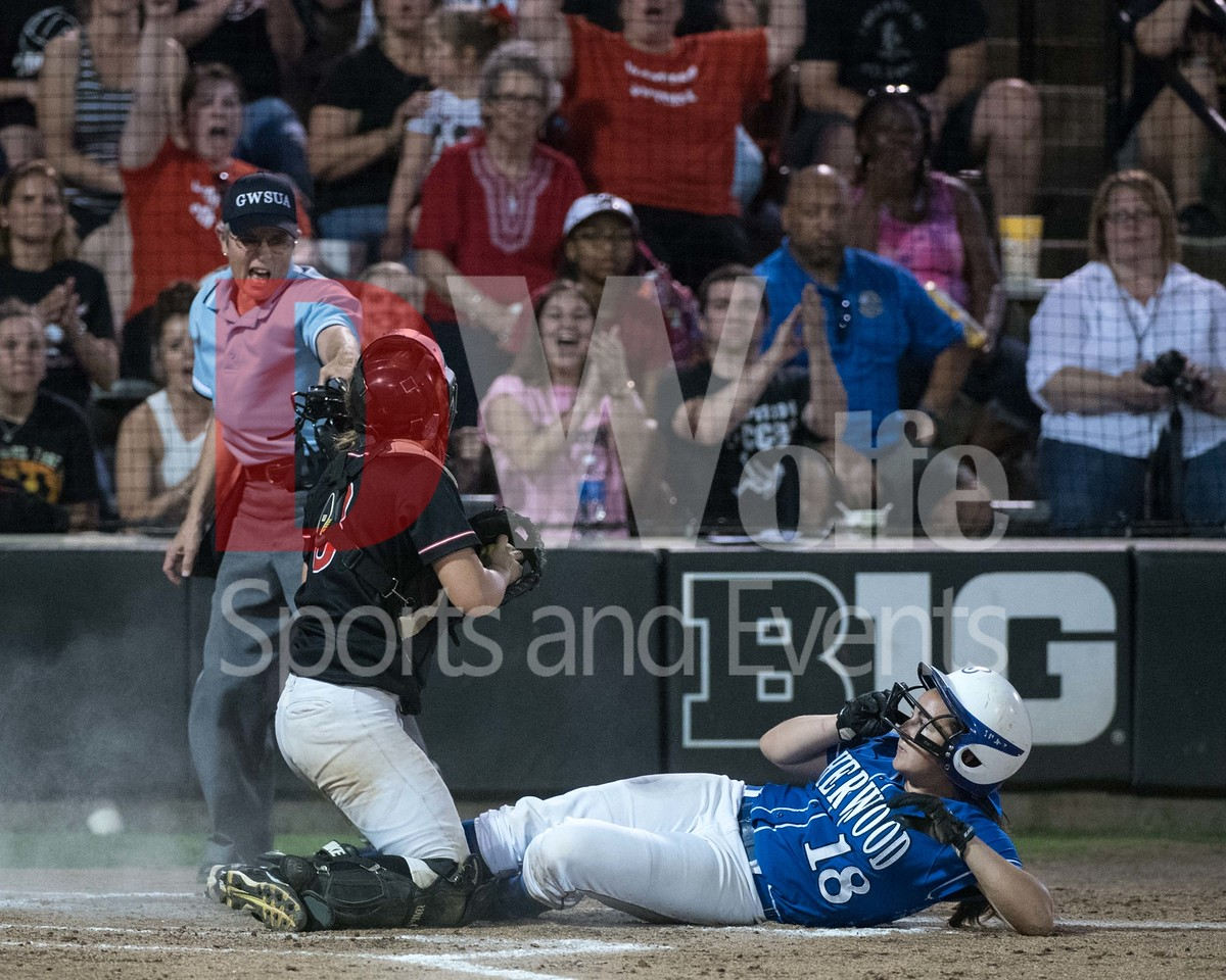 Sherwood Senior Ashley Lakey, a right fielder, slides into home and is called out by the umpire to the delight of the Chopticon fans behind the plate.