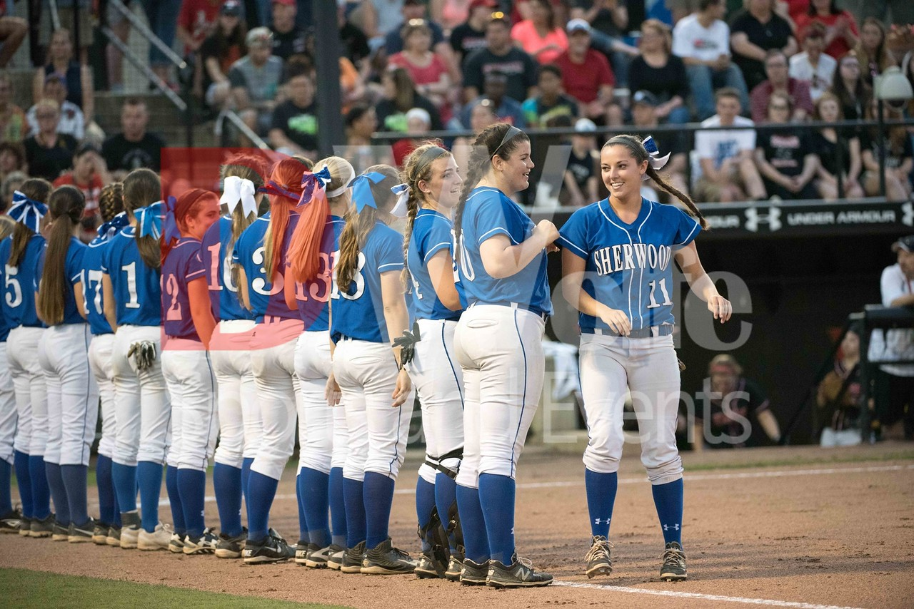 The Sherwood 4A softball team lines up for the opening announcements