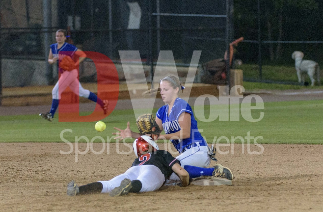 Sherwood senior Hanna Nalls boobles the ball at second base allowing Chopticon's third baseman to take second base on a forward diving slide.