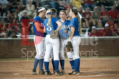 Bottom of the 4th inning and the Sherwood girls take a quick confab to regain their composure.