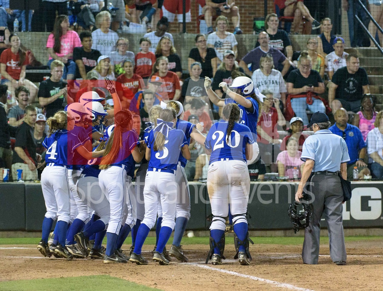The whole Sherwood team rushes home plate to welcome ( senior Kara Carney?) who hit a home run ball out of the park to seal Sherwood's 5th straight Maryland 4A championship win in softball.
