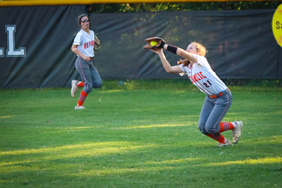 Riley Laub makes a running catch in right field as Megan Weis looks on at Willard.