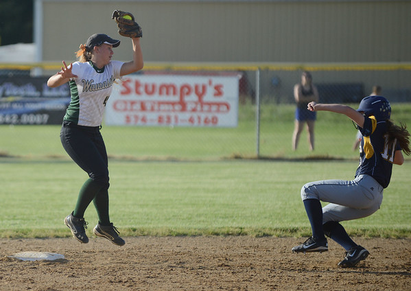 HALEY WARD | THE GOSHEN NEWS<br /> Wawasee senior Kylee Rostochak catches the ball to tag Fairfield freshman Lyndsey Bradley during the 3A Sectional Championship on Thursday at Fairfield High School. Fairfield defeated Wawasee 1-0.