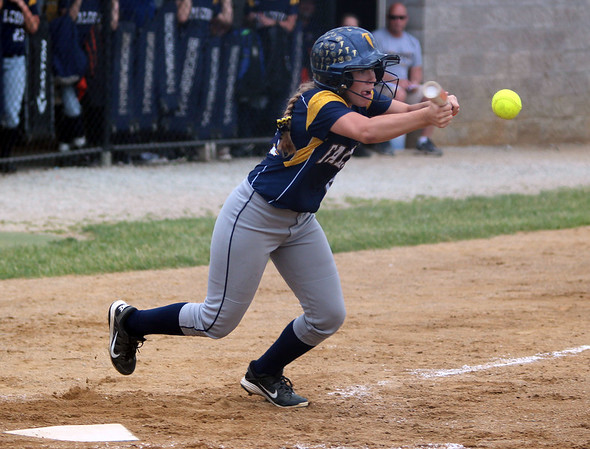 STEPHEN BROOKS | THE GOSHEN NEWS<br /> Fairfield senior Alexis Zook lays down a bunt during Tuesday's 3A softball regional championship against Fort Wayne Bishop Dwenger. Fairfield won 3-2.