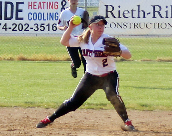 STEPHEN BROOKS | THE GOSHEN NEWS<br /> NorthWood junior second baseman Summer Stillson looks to throw to first base during Tuesday's 3A sectional semifinal against Wawasee at Fairfield High School. Wawasee won 12-1 to advance to the sectional championship.