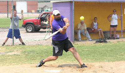 Jarod Dean on C/M Livestock gets ready to connect with the ball during the softball tournament in Bridgeport on Saturday. His team lost to Trinidad Bean.