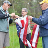 Dave Madigan, State Representative Steve DiNatale, and Rick Clouthier work together to raise the new flag donated by DiNatale and Leominster Mayor Dean Mazzarella. SENTINEL & ENTERPRISE / Ashley Green