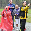Jillian Berube, Peter Hanley, Travis Nicholson, and Matthew Clouthier help sing the National Anthem before the opening game of the 25th season of the Challenger Softball League at Coggshall Park in Fitchburg on Saturday morning. SENTINEL & ENTERPRISE / Ashley Green