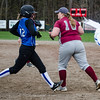 Leominster's Morgan Cormier is tagged out at first by Fitchburg's Hannah Faulkner on Wednesday afternoon. SENTINEL & ENTERPRISE / Ashley Green
