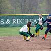 A Salem State baserunner slides safely under the tag of Fitchburg State's Maddie Medina during the game on Thursday afternoon. SENTINEL & ENTERPRISE / Ashley Green