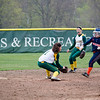A Salem State baserunner slides safely under the tag of Fitchburg State's Maddie Medina during the game on Thursday afternoon. SENTINEL & ENTERPRISE / Ashley Green