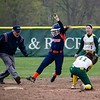A Salem State baserunner slides safely past the tag of Fitchburg State's Maddie Medina during the game on Thursday afternoon. SENTINEL & ENTERPRISE / Ashley Green