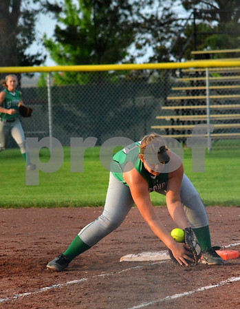 - Messenger photo by Britt Kudla<br /> St. Edmond's Jessica Kuebler attempts to stop the ball from going foul during Tuesday game against Hampton-Dumont