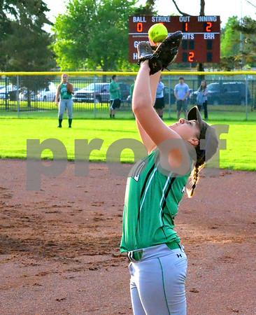 - Messenger photo by Britt Kudla<br /> St. Edmond's Jessica Kuebler catches a pop fly against Hampton-Dumont on Tuesday at Roger's Park