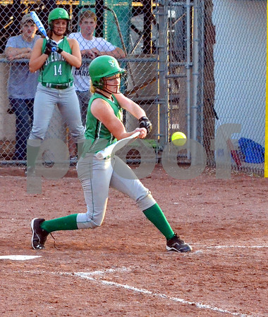 - Messenger photo by Britt Kudla<br /> St. Edmond's Maggie Harvey connects with the ball during Tuesday game against Hampton-Dumont at Roger's Park