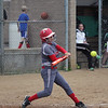 GREG KEIM | THE GOSHEN NEWS<br /> Senior Emily Castillo swings at a pitch for the Goshen RedHawks in a high school softball game Wednesday at Concord.