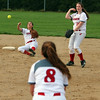 STEPHEN BROOKS | THE GOSHEN NEWS<br /> Goshen senior shortstop Emily Castillo, left, makes a throw to first baseman Reagan Wilson (8) while falling to the ground during Friday's game against Concord at Shanklin Park. Goshen won 4-3.