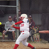 GREG KEIM | THE GOSHEN NEWS<br /> Freshman Ashton Darnell swings at a pitch for the Goshen RedHawks in a high school softball game Thursday  with Mishawaka at Shanklin Park in Goshen.