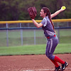 GREG KEIM | THE GOSHEN NEWS<br /> Junior pitcher Kate Atkinson fires a pitch for the Goshen RedHawks in an NLC high school girls softball game against the Northridge Raiders Thursday in Middlebury.
