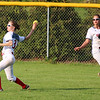 STEPHEN BROOKS | THE GOSHEN NEWS<br /> Goshen sophomore outfielder Shelby Yoder, left, winds up for a throw during Friday's game against Warsaw at Shanklin Park. The RedHawks won 6-4.