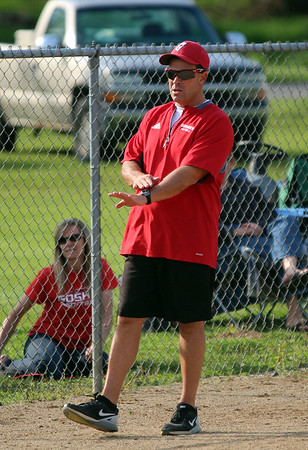 STEPHEN BROOKS | THE GOSHEN NEWS<br /> Goshen softball coach Brent Kulp gives signs to a batter during Friday's game against Warsaw at Shanklin Park. The RedHawks won 6-4 to mark Kulp's 300th career victory.