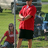 STEPHEN BROOKS   THE GOSHEN NEWS<br /> Goshen softball coach Brent Kulp gives signs to a batter during Friday's game against Warsaw at Shanklin Park. The RedHawks won 6-4 to mark Kulp's 300th career victory.