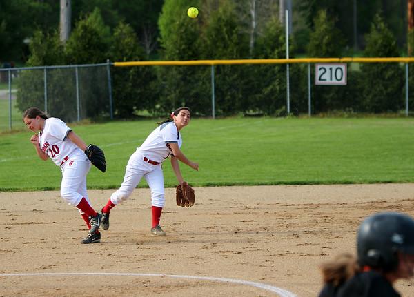 STEPHEN BROOKS | THE GOSHEN NEWS<br /> Goshen senior shortstop Emily Castillo, center, makes a throw to first base during Friday's game against Warsaw at Shanklin Park. The RedHawks won 6-4.
