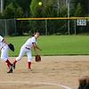 STEPHEN BROOKS   THE GOSHEN NEWS<br /> Goshen senior shortstop Emily Castillo, center, makes a throw to first base during Friday's game against Warsaw at Shanklin Park. The RedHawks won 6-4.