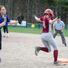 Fitchburg High's Emma Auger grabs a hit during the 15-10 loss to Lunenburg on Friday morning. SENTINEL & ENTEPRISE / Ashley Green
