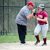 Fitchburg High's Samantha Aldrich high fives coach Mike Dupuis while rounding third after hitting a homerun during the 15-10 loss to Lunenburg on Friday morning. SENTINEL & ENTEPRISE / Ashley Green