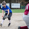 Lunenburg's Leah Sowerbutts picks up a bunt during the 15-10 win over Fitchburg on Friday morning. SENTINEL & ENTEPRISE / Ashley Green