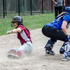 Fitchburg High's Judy Duong slides safely into home during the 15-10 loss to Lunenburg on Friday morning. SENTINEL & ENTEPRISE / Ashley Green