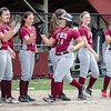 Fitchburg High's Samantha Aldrich high fives teammates while approaching the plate after hitting a homerun during the 15-10 loss to Lunenburg on Friday morning. SENTINEL & ENTEPRISE / Ashley Green