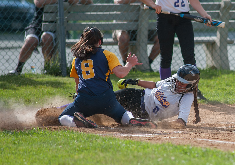 Monty Tech's Xena Tejada slides in safe at home to score the eventual game winning run in the 3rd inning against Littleton. The Bulldogs won 3-0. SENTINEL&ENTERPRISE/ Jim Marabello