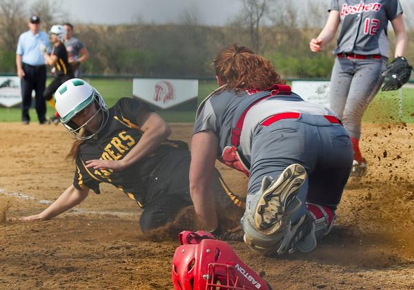SAM HOUSEHOLDER | THE GOSHEN NEWS<br /> Goshen senior catcher Jessica DeStefano tries to tag out Northridge sophomore Kylee Lantz during the game Wednesday.