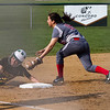 SAM HOUSEHOLDER | THE GOSHEN NEWS<br /> Goshen third baseman sophomore third baseman Emily Castillo tries to tag out Northridge senior Grace Grevengoed during the game Wednesday.