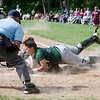 Millbury's Gabby Hunt slides safely under the tag of Oakmont's Rachel Sinclair on Saturday afternoon. SENTINEL & ENTERPRISE / Ashley Green