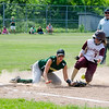 Millbury's Gabby Hunt slides safely under the tag of Oakmont's Brihanna Barry on Saturday afternoon. SENTINEL & ENTERPRISE / Ashley Green