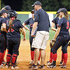 Head Coach Chris Beck for Laake Travis visits the mound to get the defense focused in a game at the 2015 UIL 6A Softball Regional Quarterfinal Lake Travis 14-6A vs Atascocita 16-6A on Thursday, May 14 in Weimar, TX