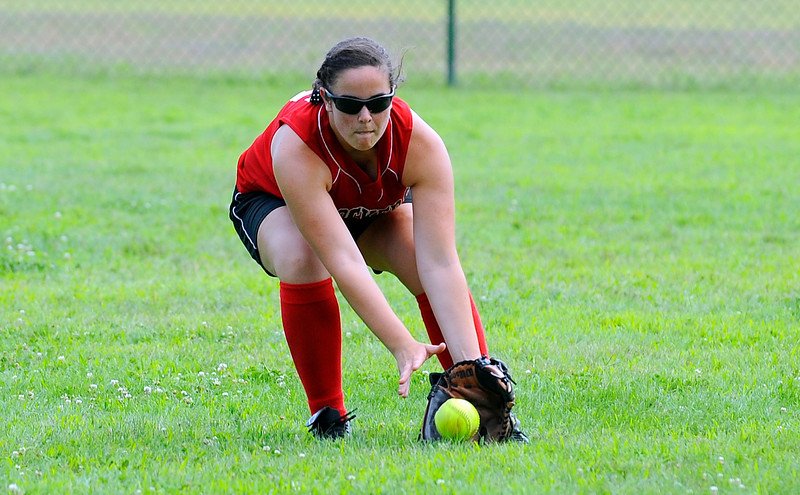 SENTINEL & ENTERPRISE / BRETT CRAWFORD<br /> Fitchburg Rockers' Hannah Davidson fields a ball in the outfield during Saturday's game against the Sterling Stingers at Coolidge Park in Fitchburg.