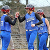 Fitchburg High School softball played Leominster High School softball on Monday afternoon at FHS. LHS's Annie Thomas(#11) get a high five from her teammate Cheyenne Frost after crossing home plate during action in the game. SENTINEL & ENTERPRISE/JOHN LOVE