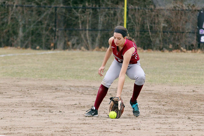 Fitchburg High School softball played Leominster High School softball on Monday afternoon at FHS. FHS's Isabel Wilder get a ground ball during action in the game. SENTINEL & ENTERPRISE/JOHN LOVE