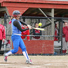 Fitchburg High School softball played Leominster High School softball on Monday afternoon at FHS. LHS's Annie Thomas makes contact with the ball during action in the game. SENTINEL & ENTERPRISE/JOHN LOVE