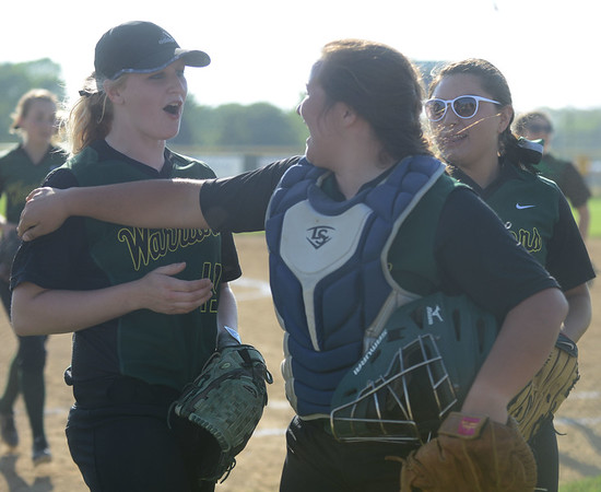 HALEY WARD | THE GOSHEN NEWS<br /> Wawasee junior Amber Lemberg, freshman Graceanna Kerlin and senior Allissa Flores (left to right) celebrate after defeating West Noble 4-1 to advance in sectionals on Monday at Fairfield High School.