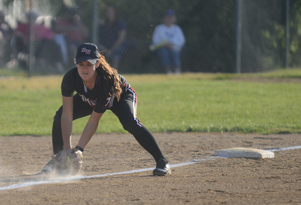 HALEY WARD | THE GOSHEN NEWS<br /> NorthWood sophomore Kylie Hochstetler grabs the ground ball during the sectional game against Tippecanoe Valley on Monday at Fairfield High School.
