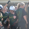 HALEY WARD | THE GOSHEN NEWS<br /> Wawasee players congratulate senior Allissa Flores (16) after she hit a homerun to help Wawasee advance in the sectional game against West Noble on Monday at Fairfield High School.